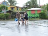 A couple of tourists walking in the rain